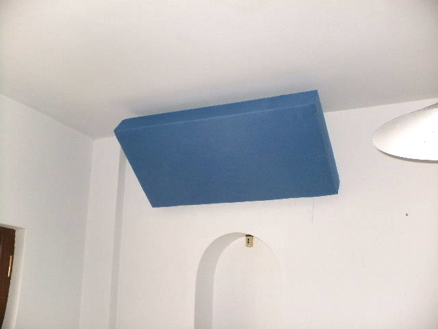 Home made bass traps mounted on wall ceiling junction